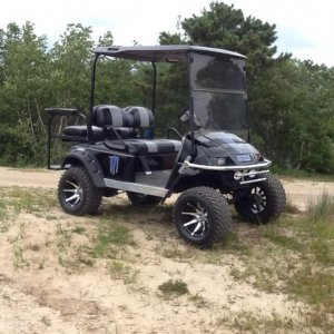 Black and blue monster cart
